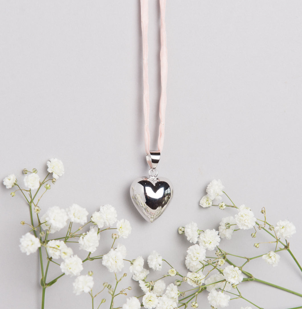 Silver plated heart Mexican bola pregnancy necklace with baby pink hand dyed silk cord