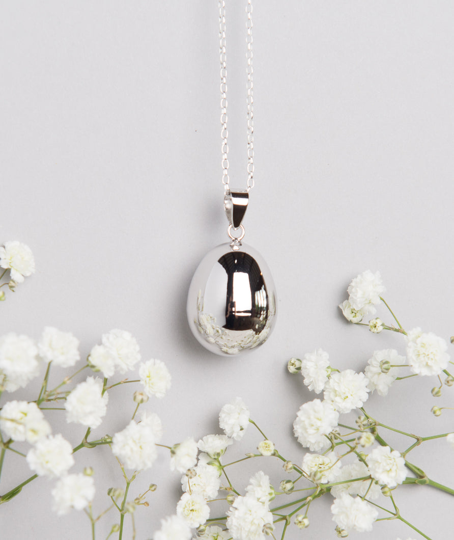silver plated pebble Mexican bola pregnancy necklace