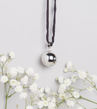 Load image into Gallery viewer, polished silver plated Mexican bola pregnancy necklace on black hand dyed silk cord