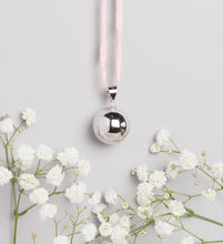 Load image into Gallery viewer, polish silver plated Mexican bola pregnancy necklace on baby pink hand dyed silk cord