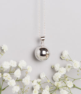 polished silver plated Mexican bola pregnancy necklace