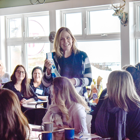 Tara Milburn, founder of Ethical Swag making a presentation about the company to a group of business women.
