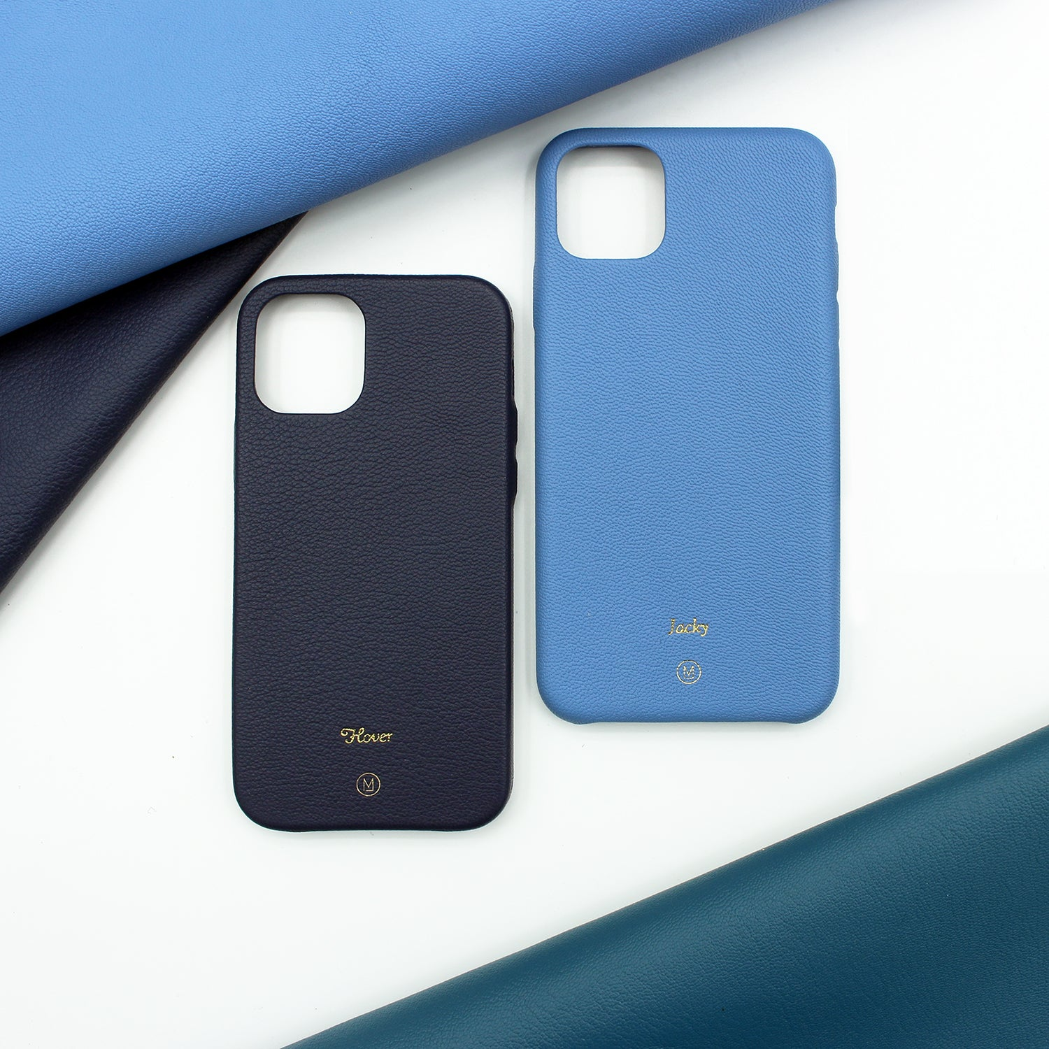 iPhone Case Bundle which includes 2 leather iPhone cases, at 15% off the original price. Different hues of blue are available. Complimentary embossing and international shipping.