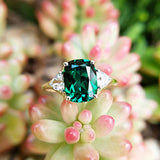 three stone emerald engagement ring