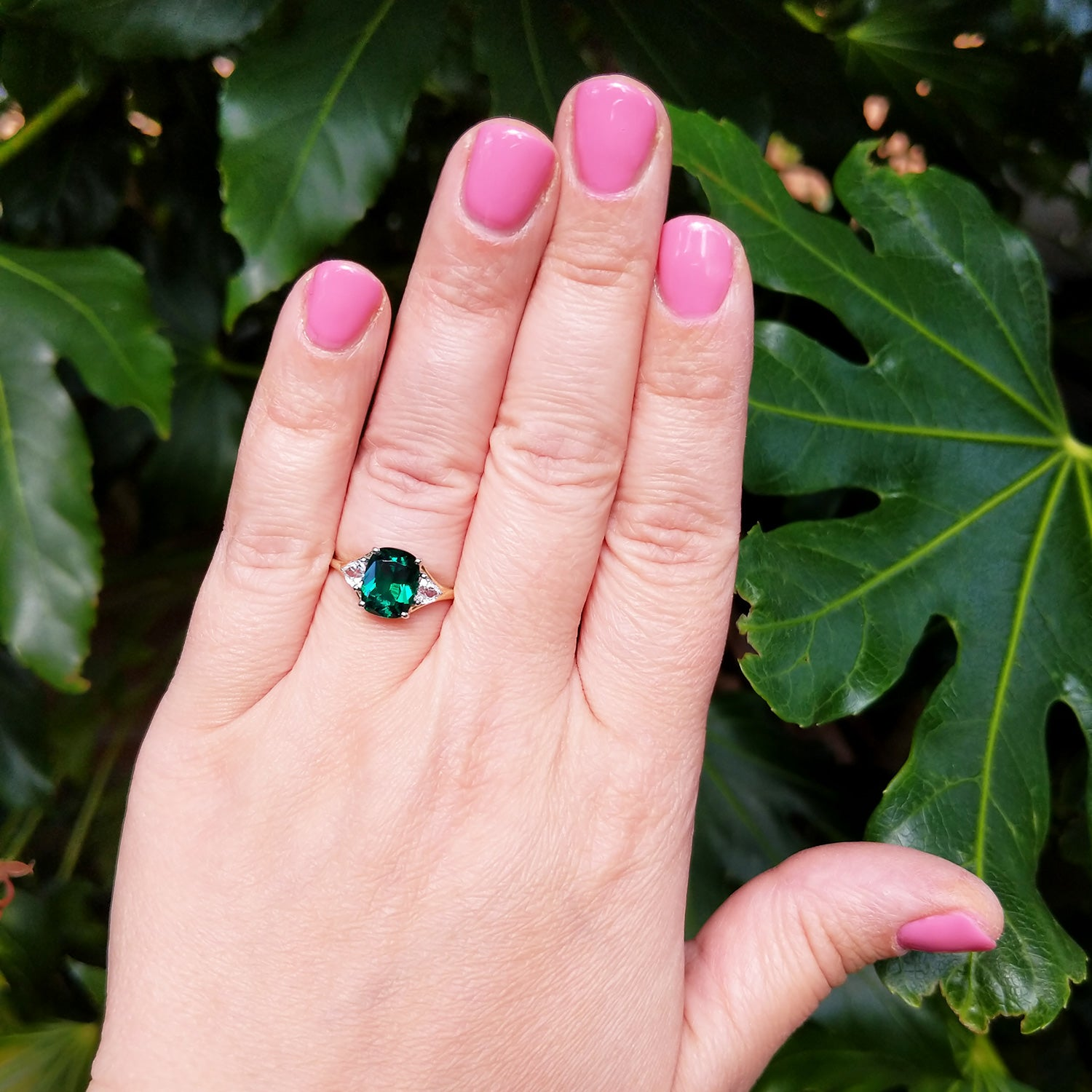 emerald three stone ring