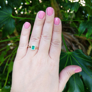 emerald ring on hand