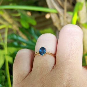 sapphire engagement ring on hand