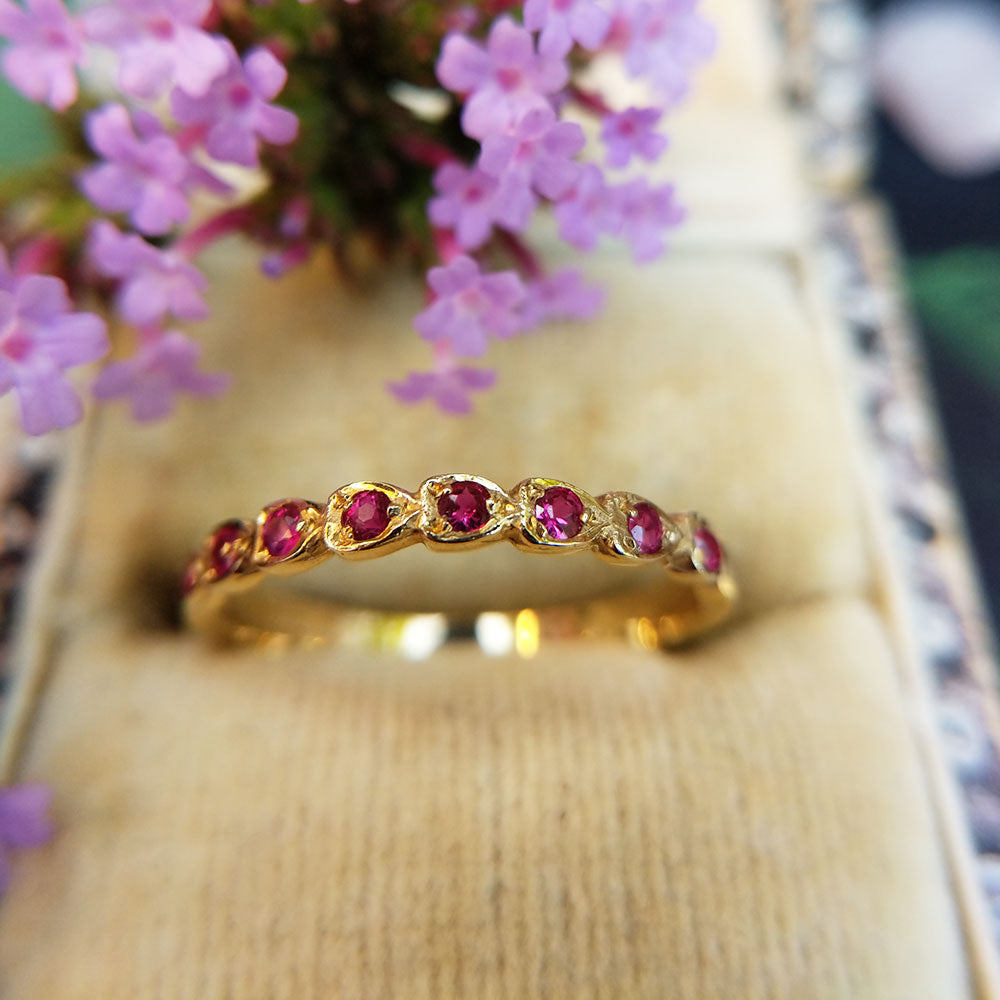 gold ruby half eternity ring