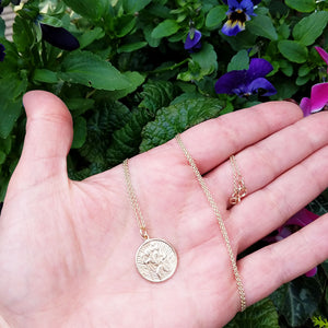St Christopher medal in hand for scale