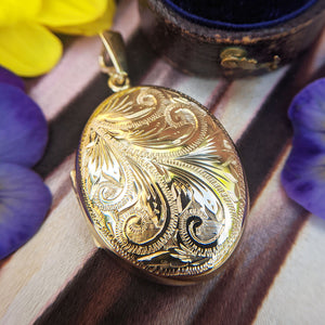 solid 9ct yellow gold locket with engraved design