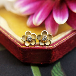 dainty gold flower stud earrings