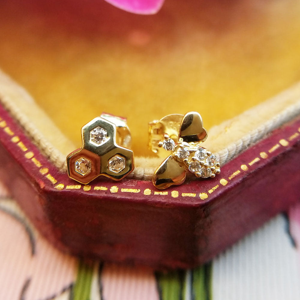 close up of bee stud earrings