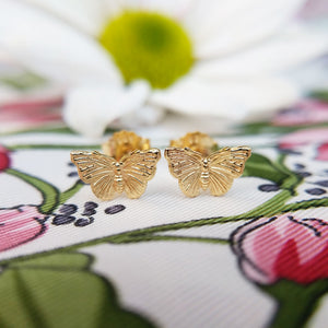 yellow gold plated butterfly stud earrings