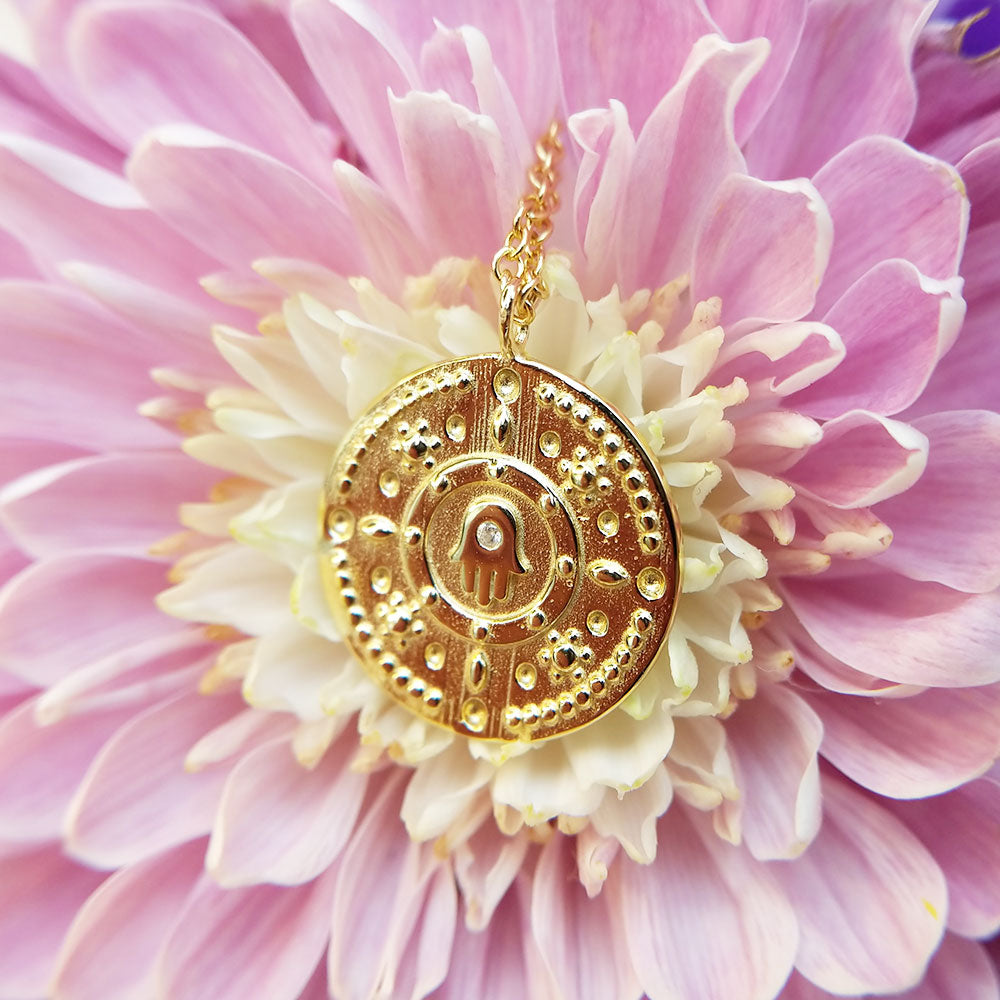 gold plated hamsa medallion necklace