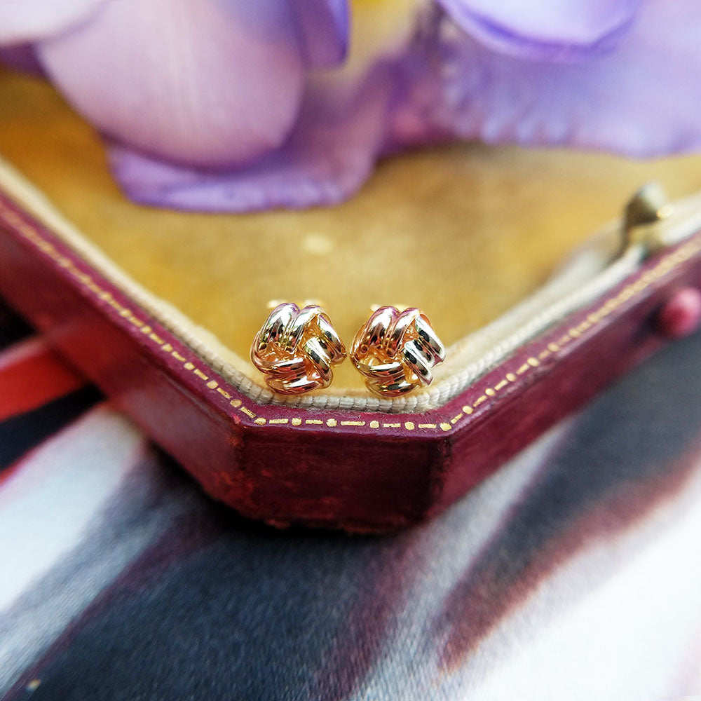 three gold knot stud earrings