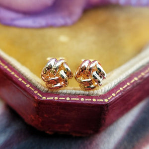 close up of knot studs made from 9ct gold