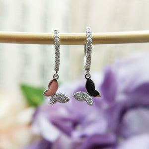 silver huggies with butterfly charms