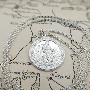 embossed st christopher design on front of pendant