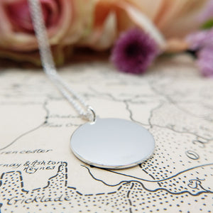 reverse of pendant, plain and polished