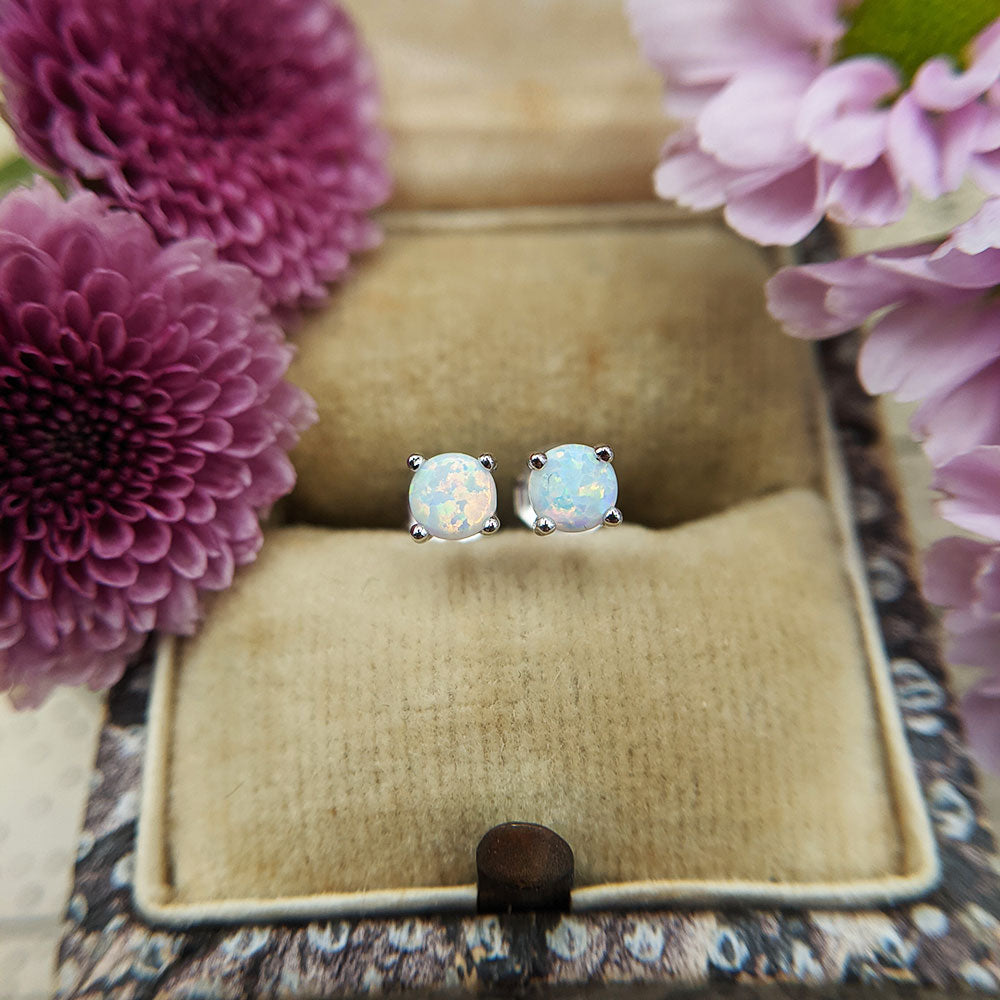 dainty opal earrings in silver