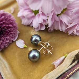 black pearl studs in 9ct gold