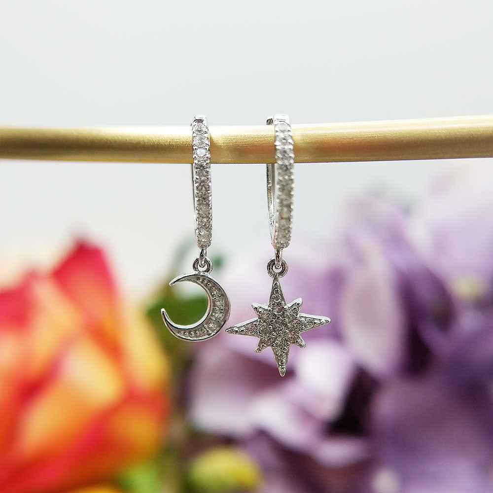 sterling silver charm huggie earrings with moon and star