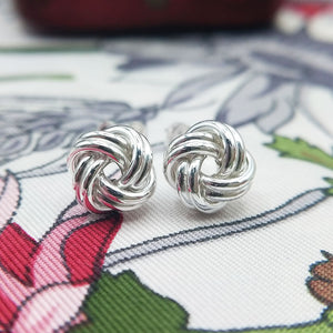 close up of silver knot studs