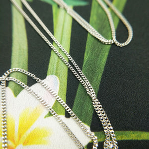 fine white gold curb chain with ladies cross