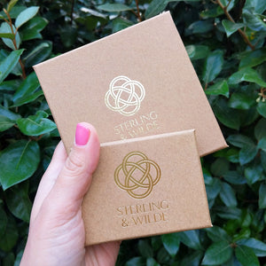 our silver huggie earring packaging