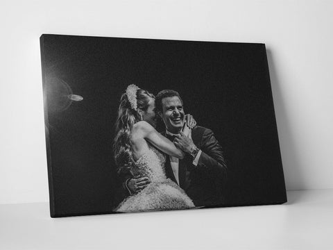 Photo of the bride and groom's wedding first dance printed in black and white on rectangular canvas.