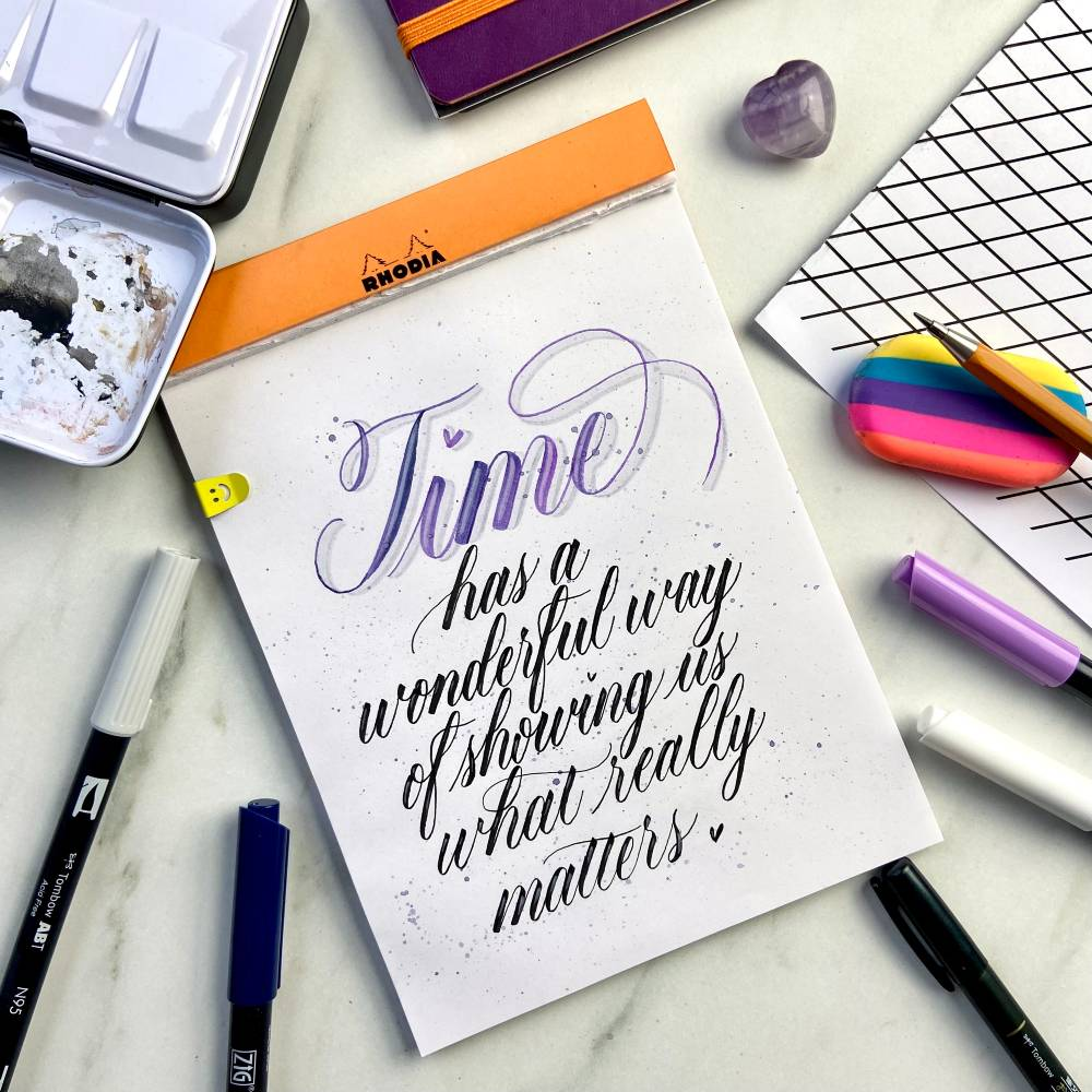 Andra mixes different brush pens in her lettering