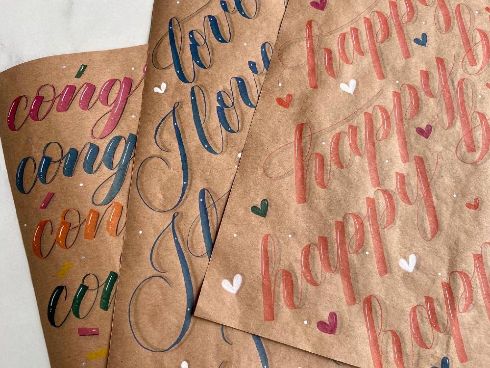Andra uses brush lettering to create her own custom wrapping paper