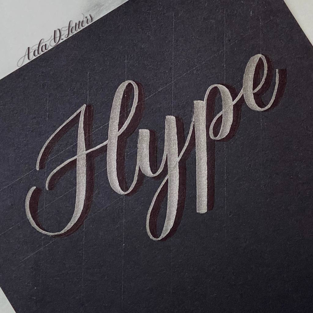 Try adding shadows to your lettering on dark paper