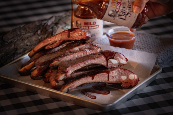 Lefty's gluten free bbq sauce is drizzled over freshly smoked bbq pork
