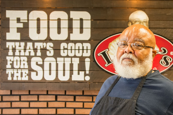 """Lefty poses with a sign that reads, """"Food that's good for the soul!"""""""