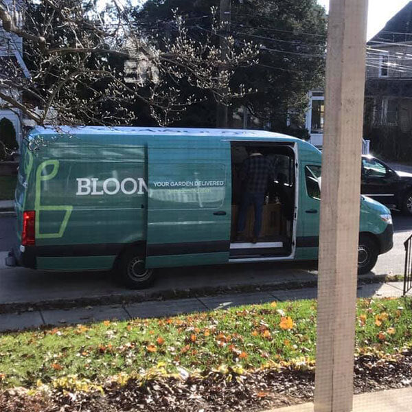 BloomBox delivery truck arriving with an order