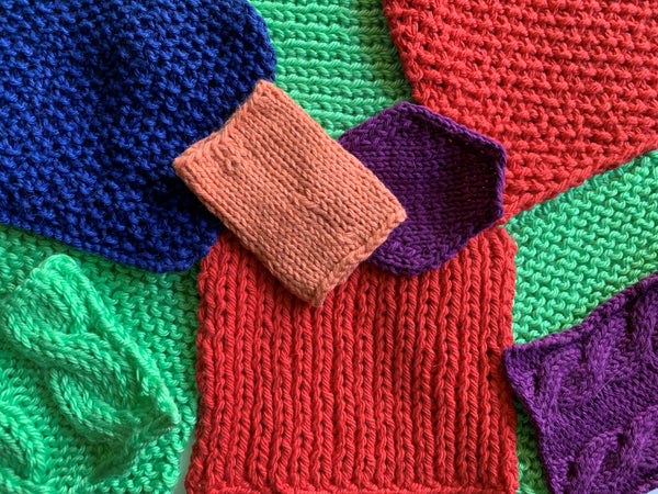 Green, red, purple, blue and orange knitted swatches are randomly laying on top of each other in squares, rectangles and a hexagon.