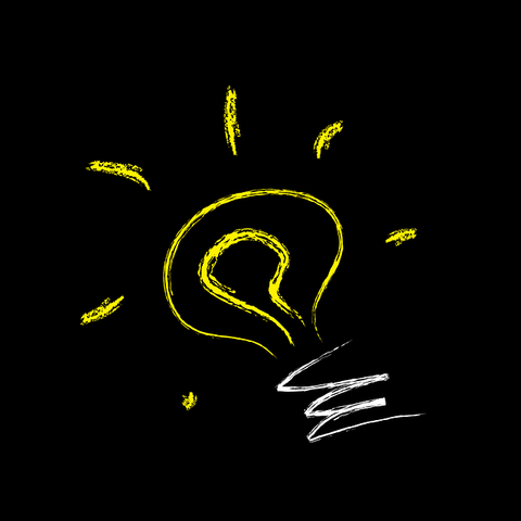 A fake yellow light bulb with a black background