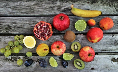 Fruit laying on a table.