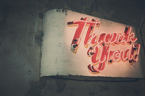 Red sign that reads thank you.