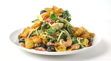 hearts of palm linguine with pesto, Mediterranean vegetables, yucca parm croutons