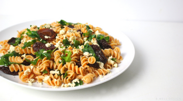 LENTIL FUSILLI WITH SUN DRIED TOMATOES AND ARUGULA TOPPED WITH