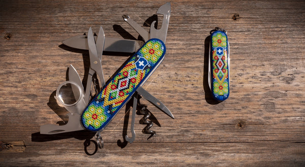 two Victorinox pocket knives with printed Huichol art, special edition