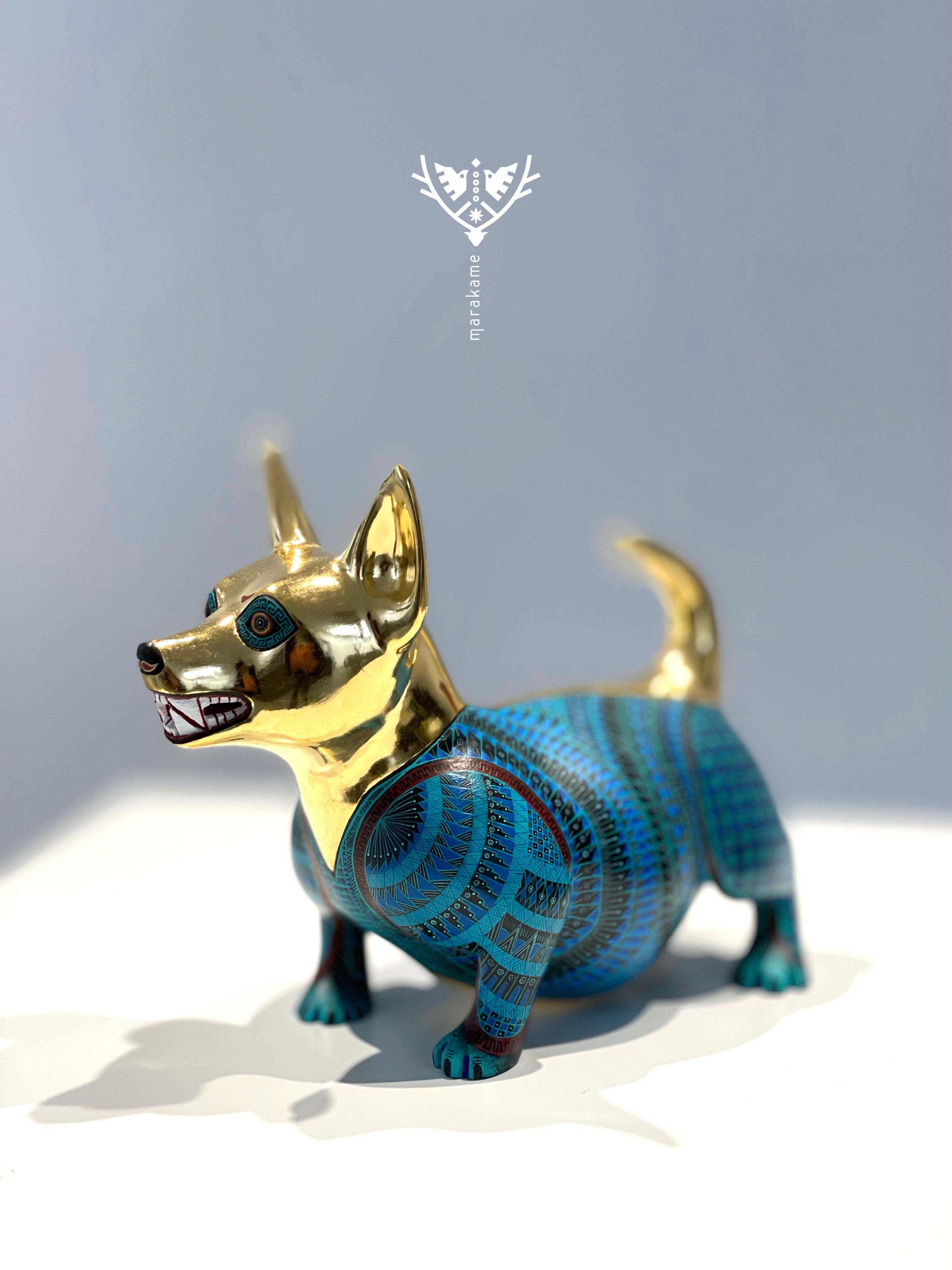 Copal wood alebrije of the Mexican tlalchichi dog with fine painted and gold leaf of Jacobo and Maria