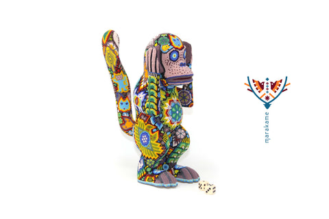 Chango, simian Zapotec Huichol Wixárika sculpture made of copal wood with chaquira and Campeche wax.