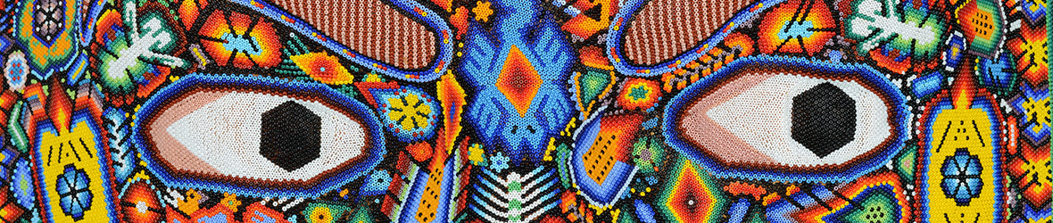 Part of a multicolored Huichol sculpture with big eyes