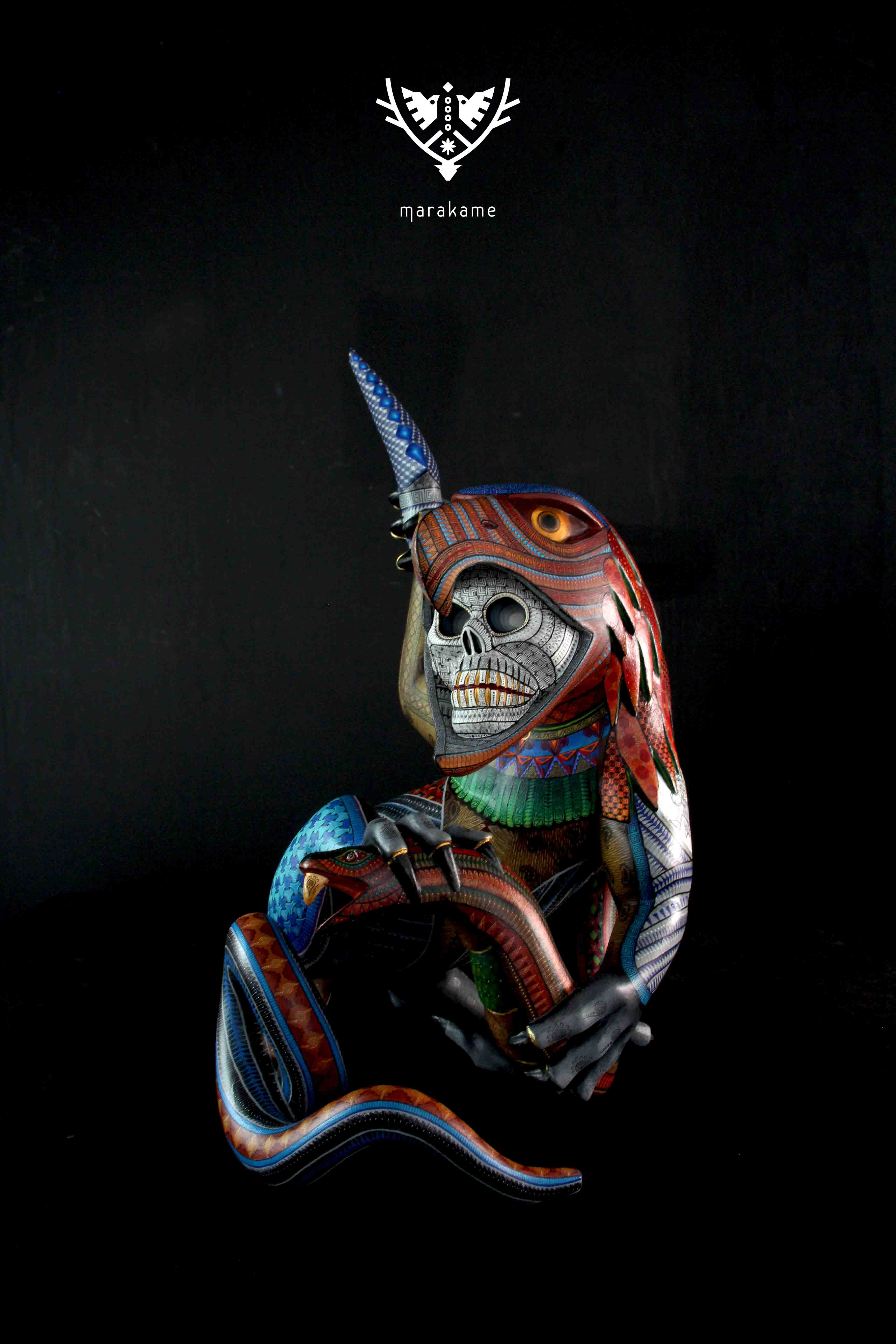 Alebrije from Oaxaca of skull skull represents death hand painted with acrylic