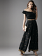 Women Black & Golden Printed Flared Palazzos