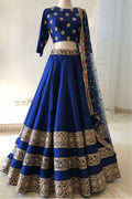 Beautiful Dark Blue Designer Partywear Embroidered Lehenga .