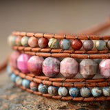 LEATHER WRAP BRACELET WITH PINK RHODONITE